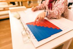 Wood montessori material, class at schoo