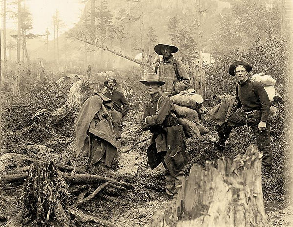 four-prospectors-posed-on-trail-in-alask