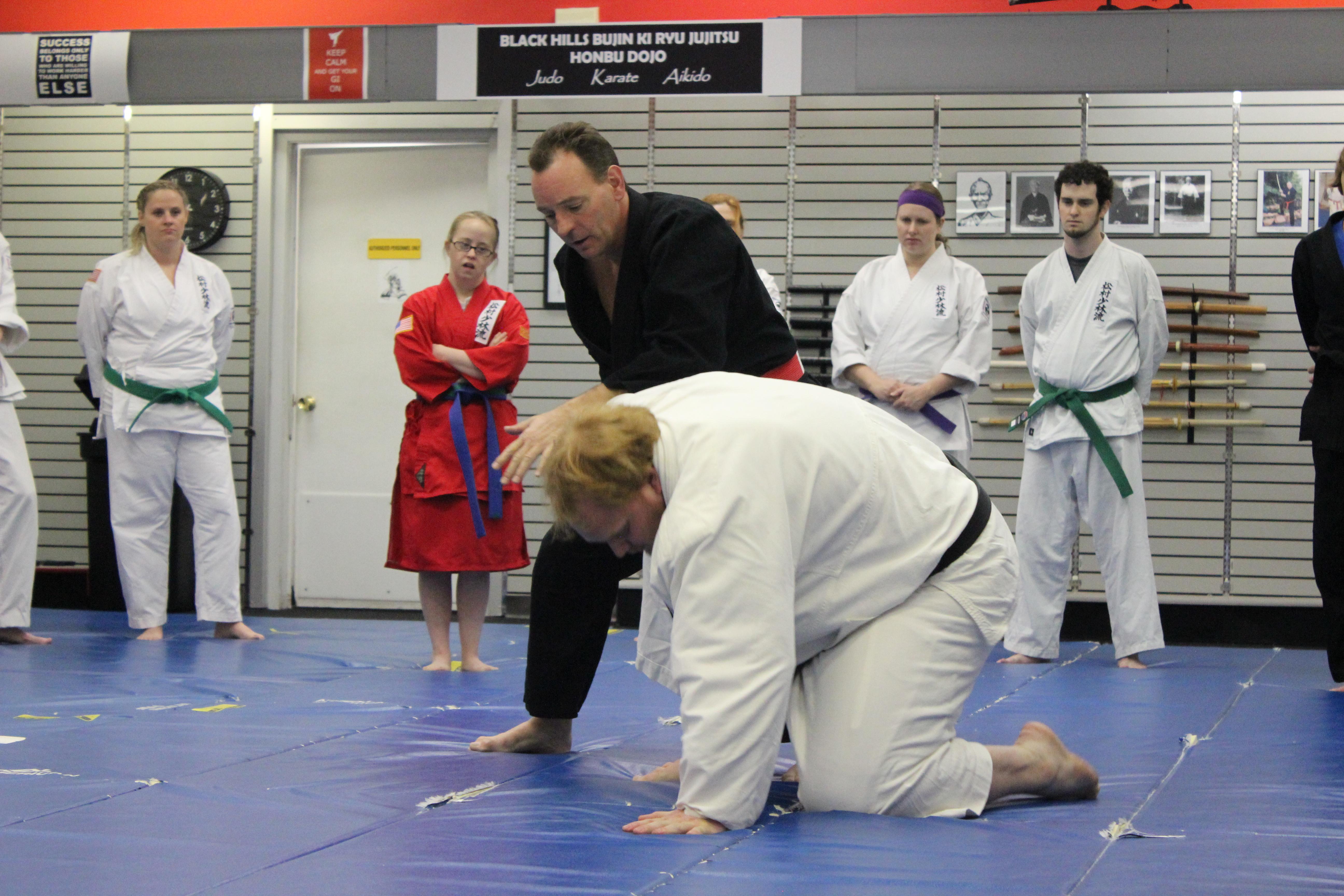 Shihan Horner demonstrating takedown
