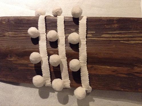Pompom trim in Ivory