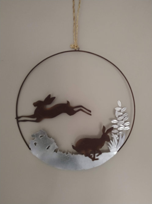 Metal wreath with running Hares