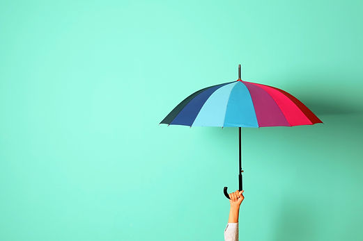 Woman holding beautiful umbrella on color background with space for design_edited.jpg