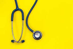 Top view blue stethoscope on yellow background. For check heart or health check up concept