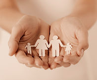 close up of womans cupped hands showing paper man family_edited_edited.jpg