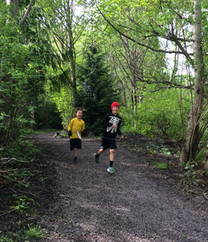 boys-in-woods-running.jpg