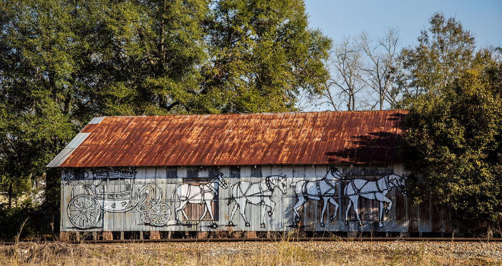 Metal Warehouse with Horses