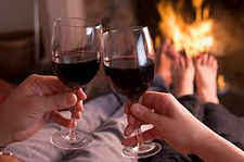 Drinking wine in front of an open fireplace at Sea Horse Diamond Beach
