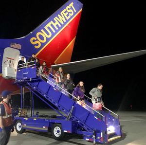 Huskies arrive in Sacramento