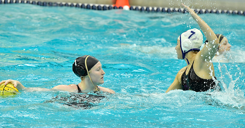 Lindenwood University's Naomi Sanders (#7) scans for an opening as the University of Washington's Natalie Erjavec (#7) closes in (Photo courtesy of the CWPA)