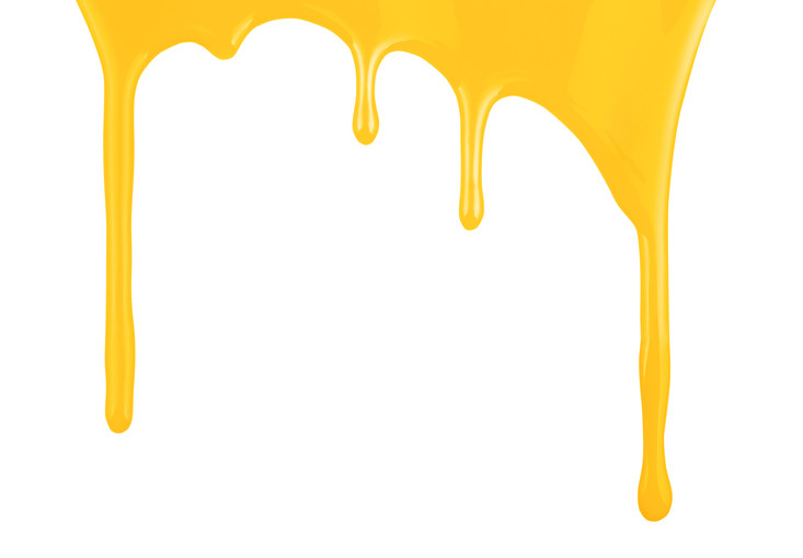 Yellow paint dripping isolated on white