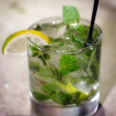 Mojito with fresh mint and sugar cane