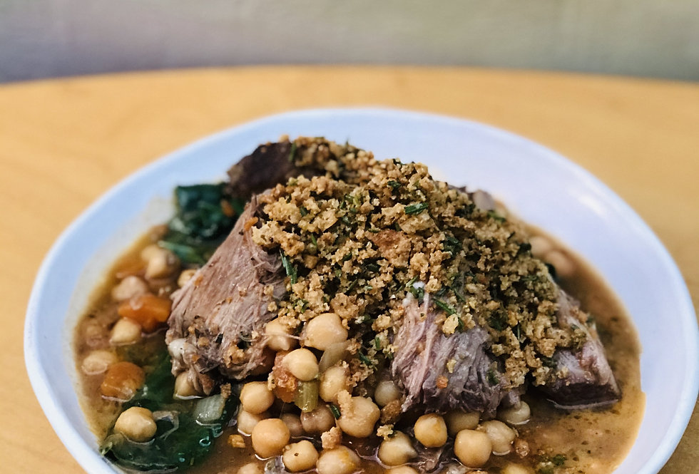6 hour slow cooked lamb shoulder with braised chickpeas, cavalo nero and garlic