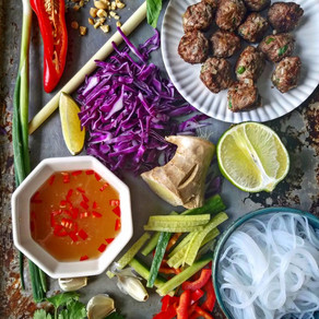 Vietnamese Lamb Meatballs with crunchy veggies, mint, rice noodles and nuoc cham dressing in a bowl