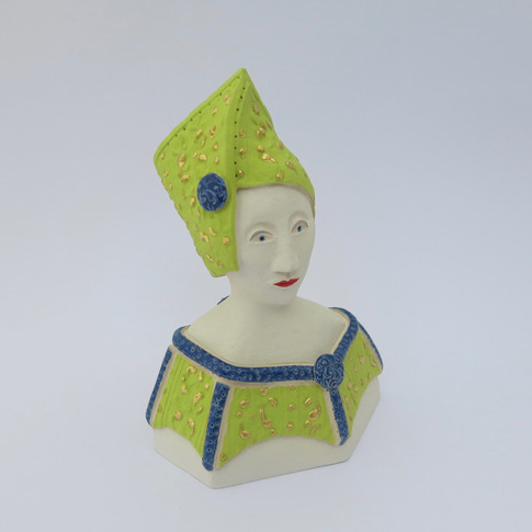 Earthenware figure decorated with underglazes and glazes.  Parts of the underglazed areas are embellished with 23.5 carat gold leaf. 14.5cm x 10.5cm x 9cm