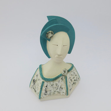 Earthenware figure decorated with copper oxide and underglazes. 14.5cm x 10.5cm x 7.5cm
