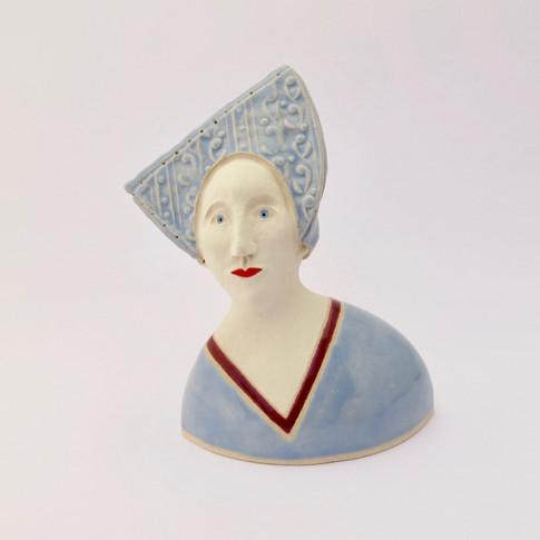Earthenware figure decorated with underglazes and glazes. 12.5cm x 10cm x 7.5cm