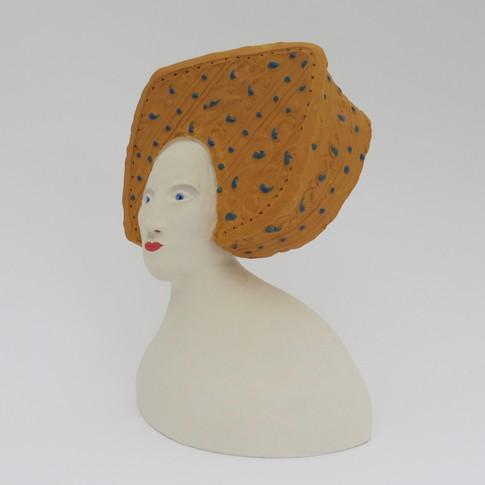 Earthenware figure decorated with underglazes and glaze 13.5cm x 11cm x 7cm