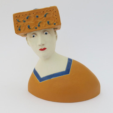 Earthenware figure decorated with underglazes and glaze. 10.5cm x 9.5cm x 7cm