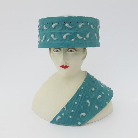 Earthenware figure decorated with underglazes and glazes 10cm x 9.5cm x 7.5cm