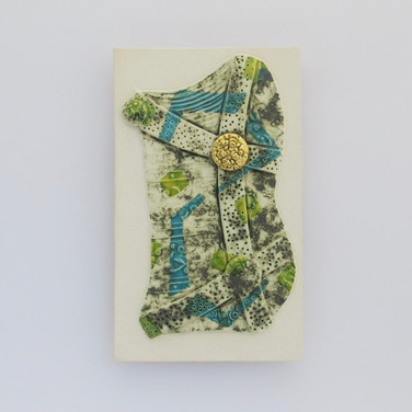 Earthenware wall plaque decorated with copper oxide and glazes.  A small area is embellished with 24.5 carat gold leaf. Hanger on the back for wall mounting. 16.5cm x 10cm x 1.75cm