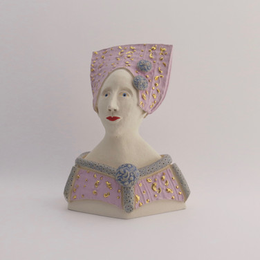 Earthenware figure decorated with underglazes and glaze.  Parts of the underglazed areas are embellished with 23.5 carat gold leaf. 14cm x 10.5cm x 7cm