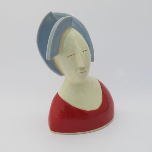Earthenware figure decorated with glaze. 12cm x 10cm x 8cm