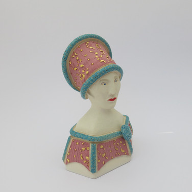 Earthenware figure decorated with underglazes and glaze.  Parts of the underglazed areas are embellished with 23.5 carat gold leaf. 15cm x 10.5cm x 7cm