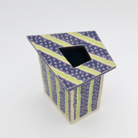 Earthenware pot decorated externally with glazes and internally with underglaze.  Not for holding water. 8.5cm x 9.5cm x 5.5cm