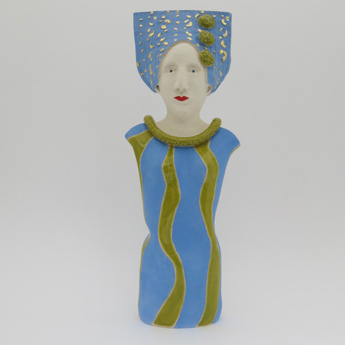 Earthenware figure decorated with underglazes and glaze.  Some areas embellished with 23.5 carat gold leaf. 24cm x 9cm x 5cm