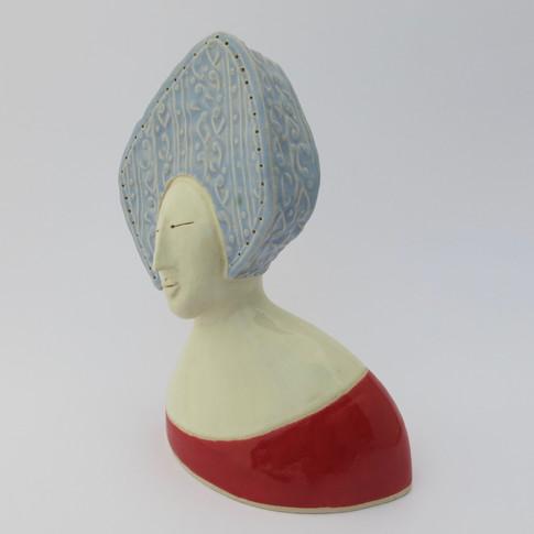 Earthenware figure decorated with glazes 14cm x 11.5cm x 6cm
