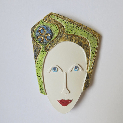 Curved earthenware ceramic face decorated with oxide and underglazes.  Some areas are further embellished with 23.5 carat gold leaf. 22cm x 13cm x 2cm