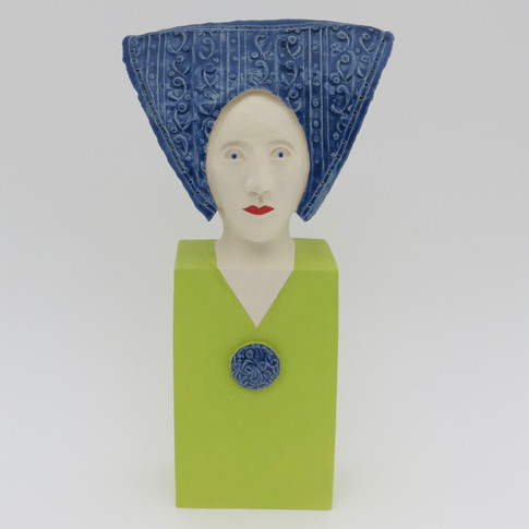 Earthenware figure decorated with underglazes and glazes 19cm x 10cm x 6cm