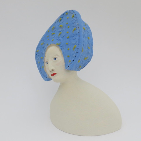 Earthenware figure decorated in underglazes and glaze 13cm x 10.5cm x 7cm