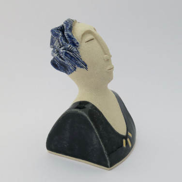 Stoneware figure partially decorated with cobalt oxide and glazes.  A small area of the figure is embellished with 23.5 carat gold leaf. 12.5cm x 6.5cm x 7.5cm