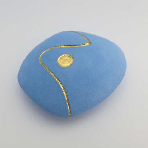 Earthenware hollow pebble decorated in underglaze and 23.5 carat gold leaf. 8cm x 7.5cm x 3cm
