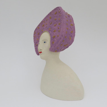 Earthenware figure decorated with underglaze and glaze 14cm x 10cm x 7.5cm