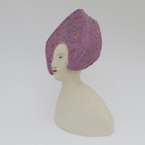 Earthenware figure decorated with underglaze and glaze 14cm x 10cm x 7.5cm
