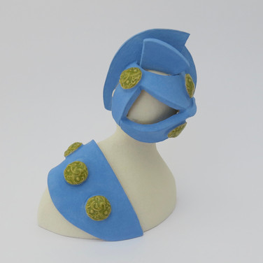Earthenware figure decorated with underglazes and glaze. 11cm x 9.5cm x 7.5cm