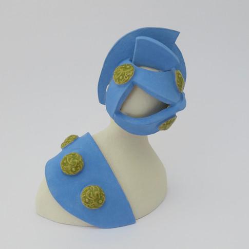 Earthenware figure decorated with underglazes and glaze. 11cm x 9.5cm x 7.5cm