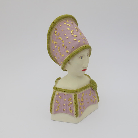 Earthenware figure decorated with underglazes and glazes.  Parts of the underglazed areas are embellished with 23.5 carat gold leaf. 14.5cm x 10.5 cm x 7cm