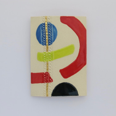 Curved stoneware wall plaque partially decorated with glazes.  A small strip is embellished with 23.5 carat gold leaf. Hanger on the back for wall mounting. 15cm x 10.5cm x 1.5cm