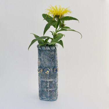 Earthenware pot decorated externally with cobalt oxide and some areas are glazed and embellished with 23.5 carat gold leaf. Internally decorated with cobalt oxide.  Not for holding water.   18.5cm x 7cm x 6.5cm