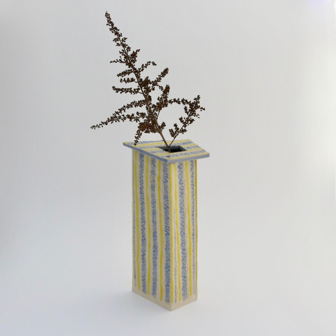 Earthenware pot decorated with glazes externally and underglaze internally.  Not for holding water. 17cm x 9.5cm x 5.5cm