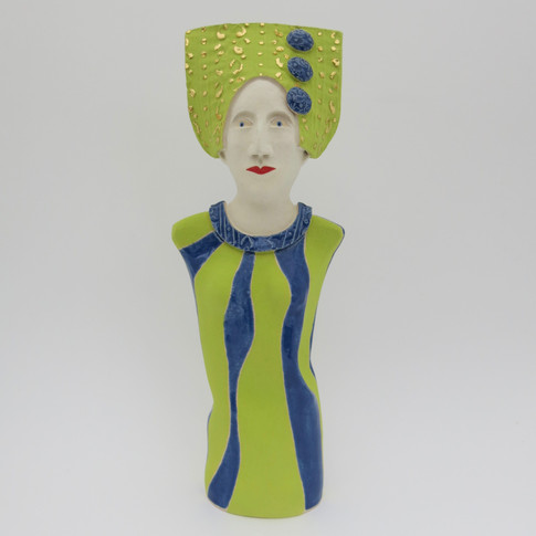 Earthenware figure decorated with underglazes and glaze.  Some areas embellished with 23.5 carat gold leaf. 24cm x 9cm x 5.5cm