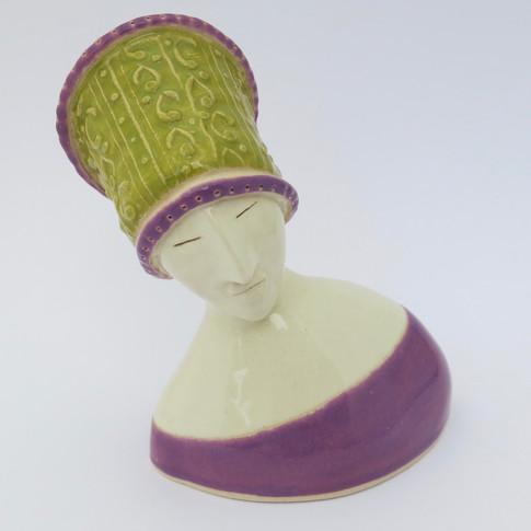 Earthenware figure decorated with glazes. 12cm x 10cm x 7cm