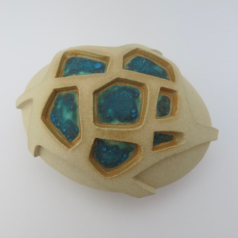 Stoneware hollow pebble with some areas glazed. 13cm x 10cm x 7cm