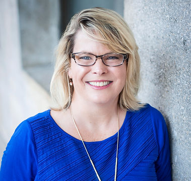 Deb photo of blond woman wearing glasses and blue shirt