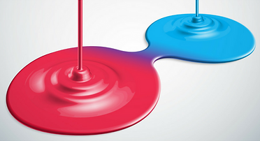 image of pool of red paint and pool of blue paint running together to form purple