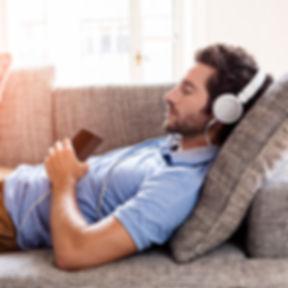 relaxation man headphones_ThinkstockPhot