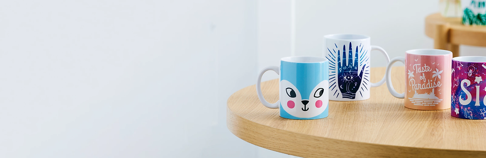 four-colorful-mugs-on-table-lg-2x.webp